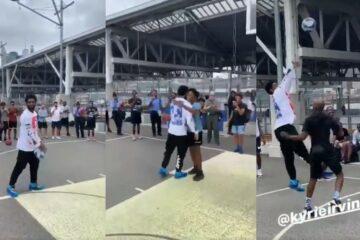 Kyrie Irving joue avec des fans