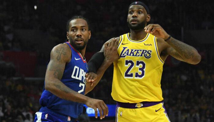 Kawhi Leonard et LeBron James durant un match entre Clippers et Lakers