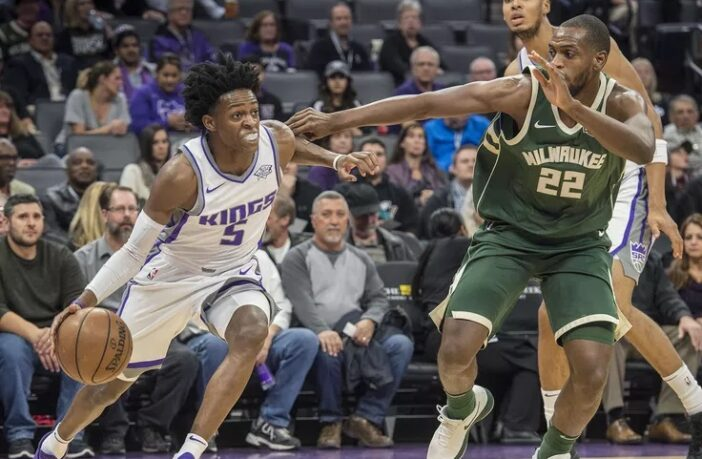 De'Aaron Fox des Kings et Khris Middleton des Bucks