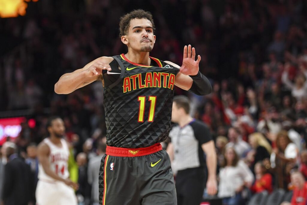 Trae Young reacts after decisive action