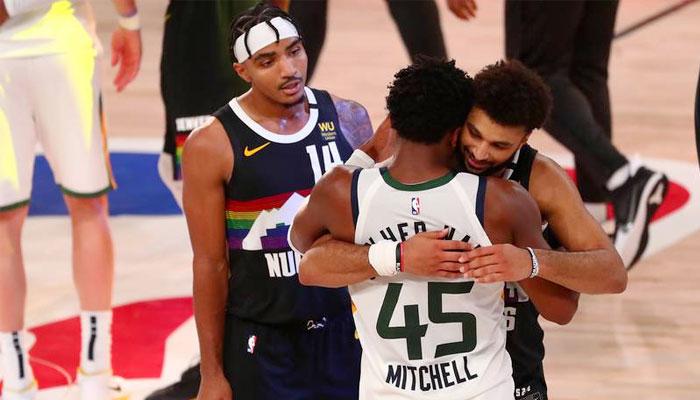 Jamal Murray et Donovan Mitchell après leur Game 7 NBA