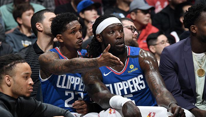 Les joueurs NBA Lou Williams et Montrezl Harrell sur le banc des Los Angeles Clippers