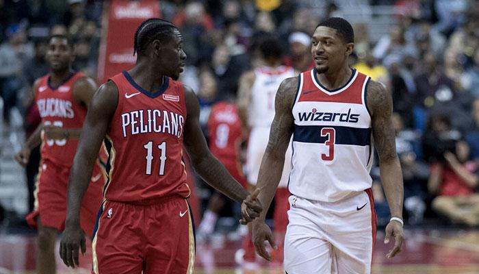 Les stars NBA Jrue Holiday (à gauche), joueur des New Orleans Pelicans, et Bradley Beal (à droite), joueur des Washington Wizards