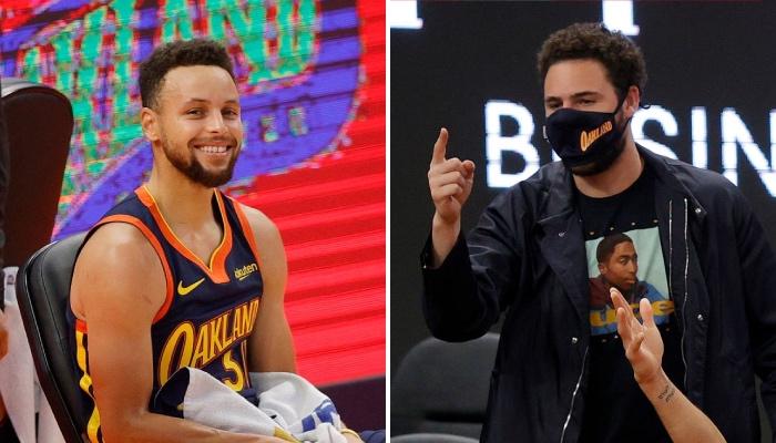 La superstar NBA des Golden State Warriors, Stephen Curry, tout sourire après avoir ignoré la main levée de son coéquipier, Klay Thompson